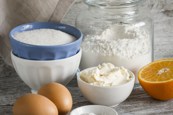raw ingredients - flour eggs butter sugar orange - to cook orange cake. Ingredients for baking. Ingredients for the dough.