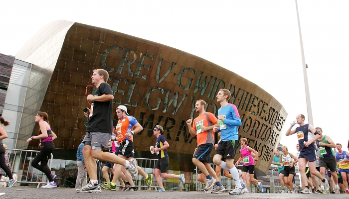 05.1014 Cardiff Half Marathon - Runners pass The Millennium Centre in Cardiff Bay © Huw Evans Agency